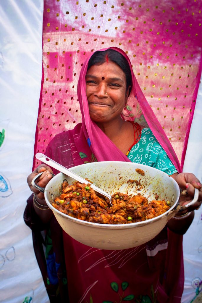 A woman holding a bowl of food
